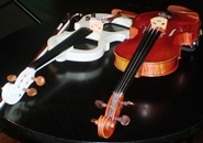 violins, white electric & brown wood